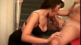Cock sucking brunette milf seduces a young guy on the stairs