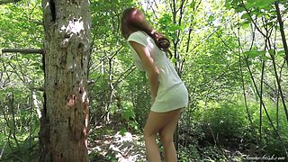 Getting au natural when she strips naked during a nature walk