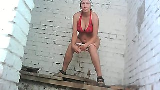 Busty white lady in red bikini pisses in the Soviet style public restroom