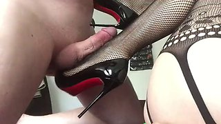 Fingering her asshole with louboutin