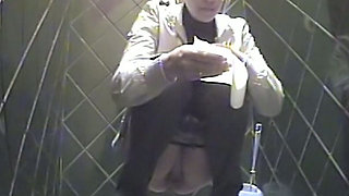 Blonde girl in black jeans pisses and wipes her pussy with toilet paper