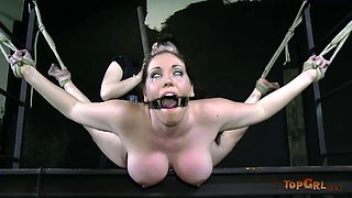 Curvy girl body bent wildly during a long bondage session
