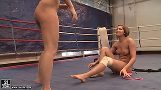 Cipriana and Barbie White exercise on the wrestling ring