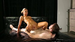 Sexy oiled up blondie Abby Cross blows big sausage of horny fellow and then rides it ardently