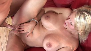Pretty milf with a nice pair of fake tits rides his rod