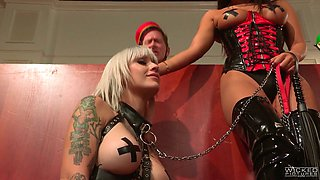 Tattooed bitch on a leash Kleio Valentien is licking pussy of sex-appeal mistress