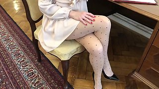 Beautiful milf secretary in silk pantyhose
