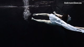 Sweet and special sexy redhead babe in white dress under water