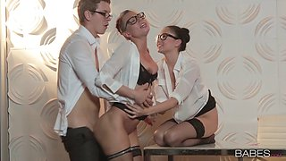 Hung boss invites his slutty assistants for a threesome in the office
