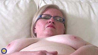 Busty amateur mature blonde Jaroline K. masturbates with glasses