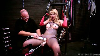 Tied up to a chair blonde gets her slit fucked with vibrator and fuck machine