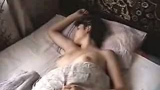 Naked Woman at Bed