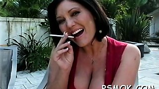 Sexy undressed playgirl provoking whilst smoking a cigarette