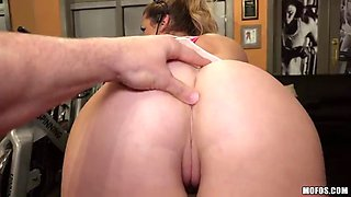 fancy brunette cowgirl face fucking a huge cock in the gym