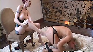 Red-haired slut makes her slave suck worship her sexy feet