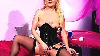 Arousing babe in corset smokes and fucks