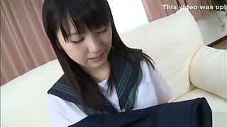 Alluring Asian teen in school uniform gets a vibrator