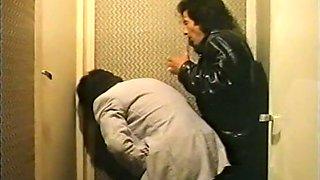 Two horny voyeur men watching sex through a keyhole