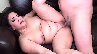Mature couple having some fun on the couch