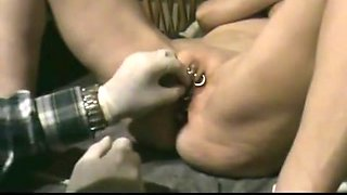 slave's pussy is pierced and shut