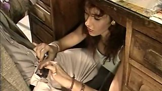 Slutty secretary gives her boss a blowjob under the table