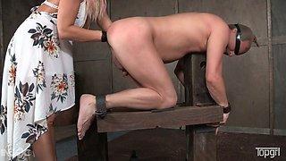 Kinky mistress London River brazenly fists her slave's butthole