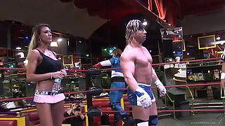blonde babe fights a guy in a wrestling match