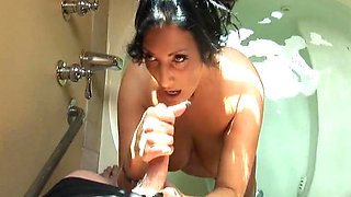 Milf with tattoos gives a deep blowjob
