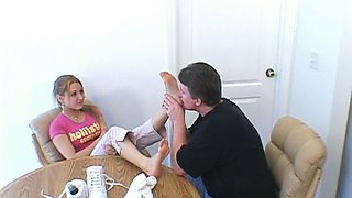 petite girl has tiny tootsies played with