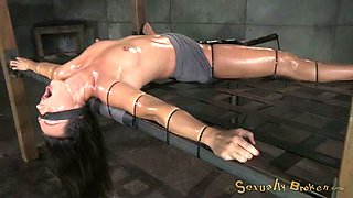 Oiled tied up and blindfolded brunette has to suck massive black cock