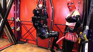 red masked rubber mistress fucks latexslave ass