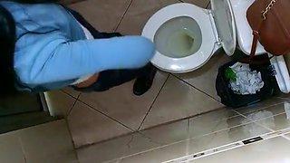Nice ass brunette spied in public toilet
