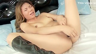 Lola spreads her sexy body across the bed and takes care of her needs
