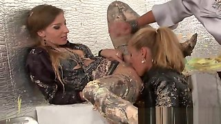 Clothed glamour babes lick clits after a food fight