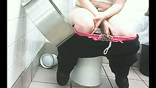 Chunky white amateur woman filmed from front in the toilet