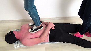 Three sexy amateur girls punishing a guy with their feet