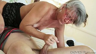 71 years old bitch in glasses seduced her young neighbor and sucked him off on sofa