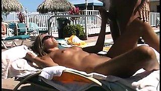 Couple sucks and fucks at the pool