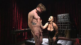 Busty mistress Bella Rossi masturbates and teases her male slave