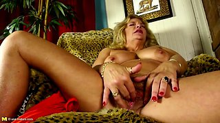 Old horny granny with hairy pussy rubs her clit
