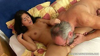 Young slut gives an old man a great blowjob in 69 pose