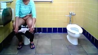Desi Nri Aunty Caught Pissing In Toilet