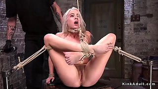Gagged and hogtied blonde in dungeon