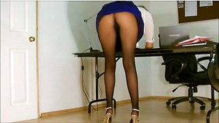 A sexy office colleague in hot skirt flashing booty