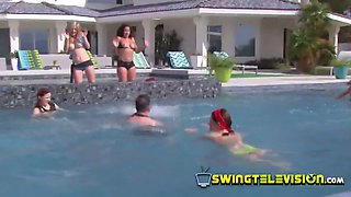 Couples have a blast playing fun games by the pool