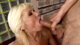 Mature blonde granny fucking with her toy boy