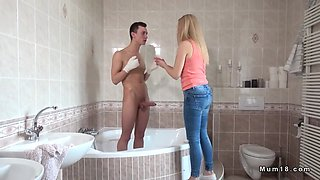 blonde milf helps young guy bath