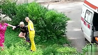 Ambulance picks up lady passed out in the grass