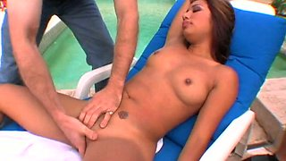 Nasty tanned gal Jasmine Bryne gets her pussy finger fucked near the pool