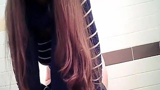 Teen in public toilet pissing